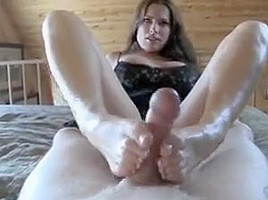 Amazing busty milf give a great footjob