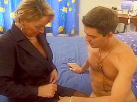 Blonde mature whore getting titty fucked before sex